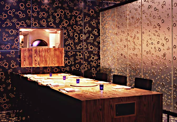 Nobu Fifty Seven is the first uptown New York restaurant for chef Nobu Matsuhisa. Its Asian-style decor includes sliced bamboo stalks embedded in terrazzo tiles.