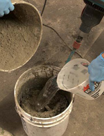 Vertical back coat, step 4: Add cement slowly while mixing. Add an additional amount of water if it is needed when making GFRC countertop mix.