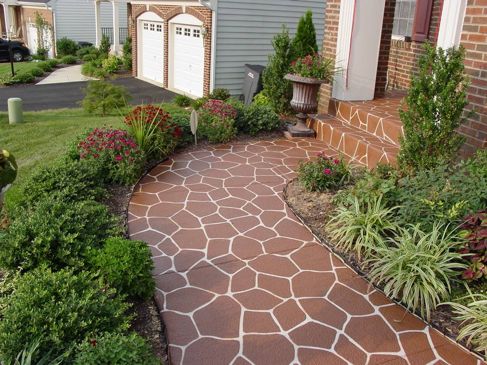Flagstone stencil concrete for this walkway leading up to a home's front porch