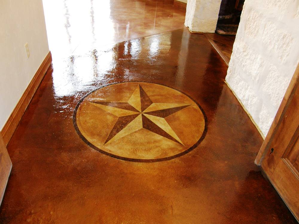Star stencil on concrete that has been stained a brown and yellow color