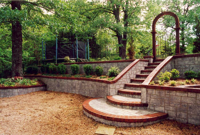 A look at a retaining wall and radius steps that help address the drainage and erosion of this space.