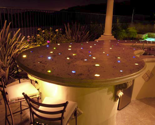 A concrete countertop that is lit with fiber optics and glass aggregate.