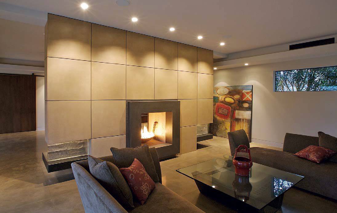 Concrete panels create this wall that a fireplace sits at.