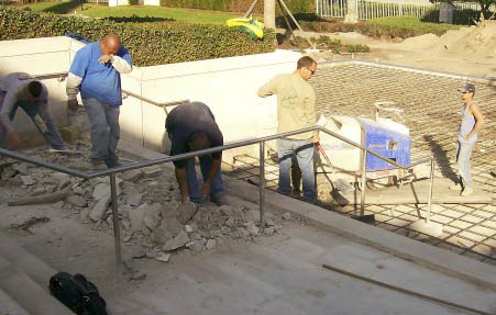 A crew breaks up concrete on the steps of this church.