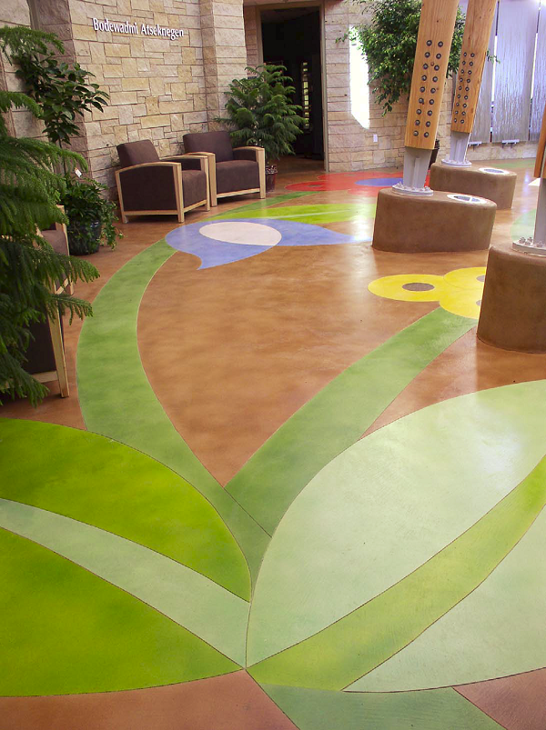 The palette for this floor at the Potowatomi Tribes Executive Building in Crandon, Wis., consisted of 10 colors of Lithochrome Tintura Stain, a waterborne stain touted by L.M. Scofield Co. as an acid stain alternative. Five were blends of base colors, to better match the rendered design. The ability to mix and match colors proved critical, given the condition of mixed pours in the work area.
