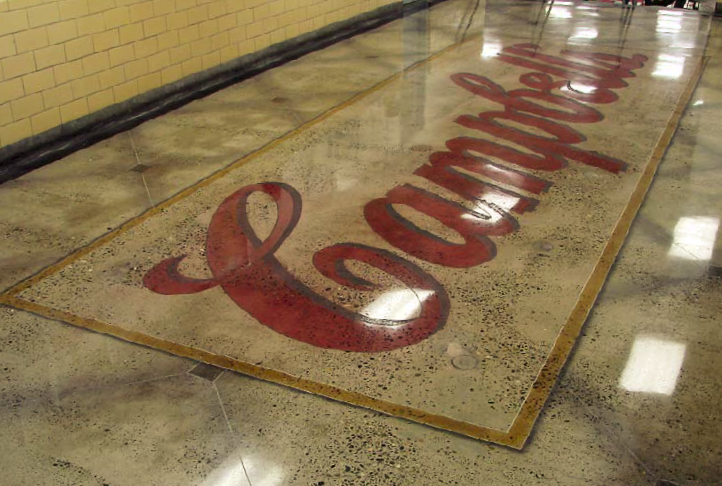 The Campbell Soup logo is placed on this concrete floor with stains and then polished to shine it up.