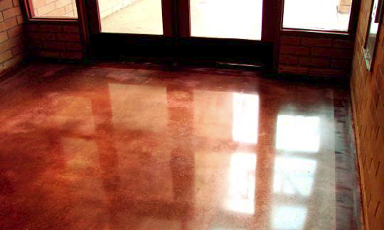 Red concrete floor that has a shiny gloss.