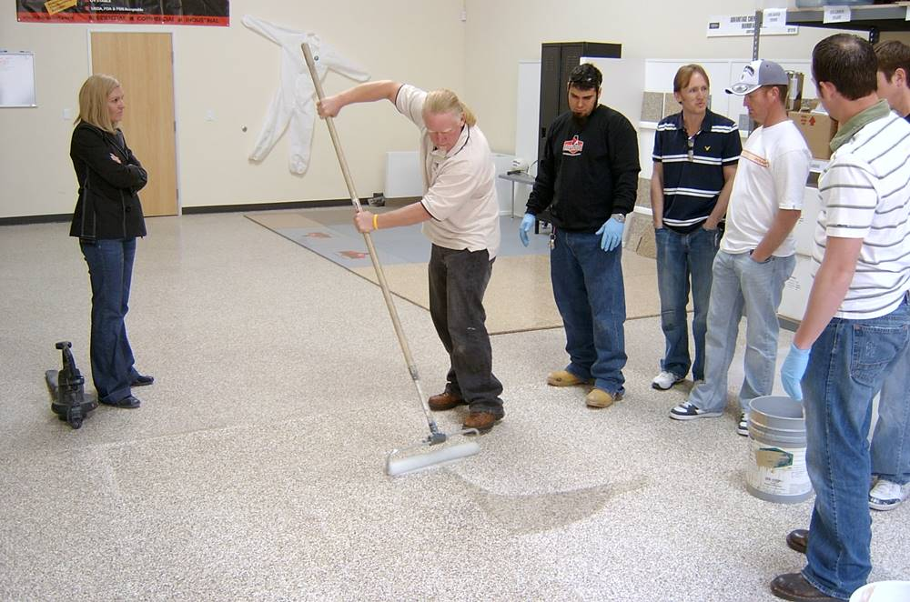 Installing polyaspartic coatings during a training class.