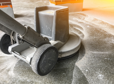 a grinder going through the concrete polishing process