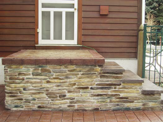 Concrete steps that are made to look like stacked stones but are sturdier and more substantial.