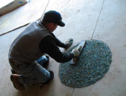 Block-outs in this market floor were seeded with transparent, round and polished jelly bean glass and exposed through washing to maintain aggregate clarity and a river-pebble pro?le.