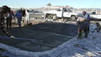 At a Las Vegas auto dealership, Chief Concrete broadcasts black glass onto a wet concrete pad, then ?oats it into the concrete surface with magnesium bull ?oats. Photos courtesy of Chief Concrete
