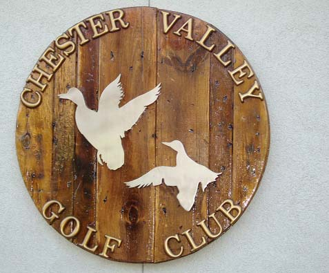 Chester Valley Golf Club sign with two ducks on a circle piece of wood.