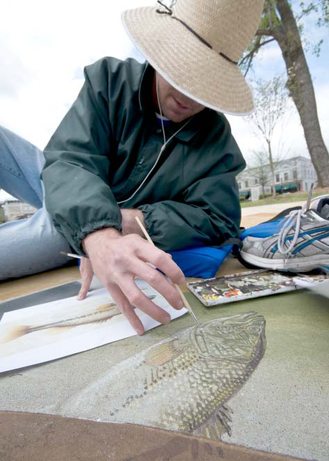 Little Rock, Ark. artist John Kushmaul paints a large mouth bass.