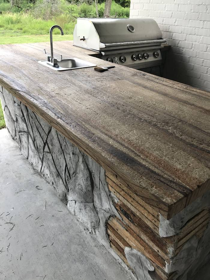 Outdoor concrete countertop made to look like wood.