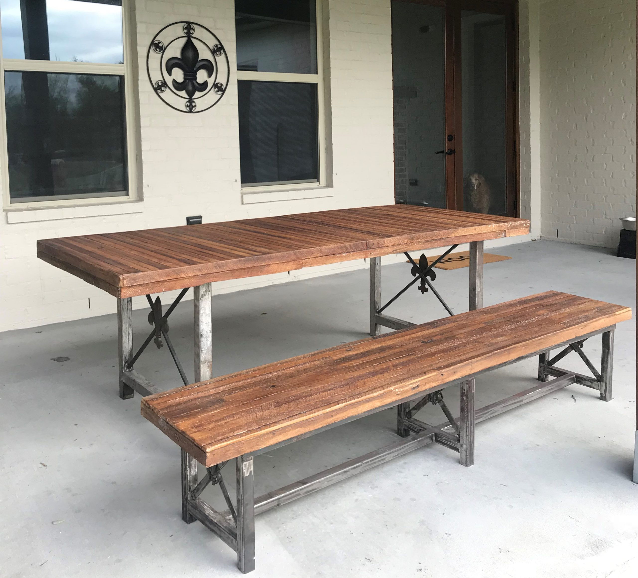 Table and bench made of concrete made to look like wood.