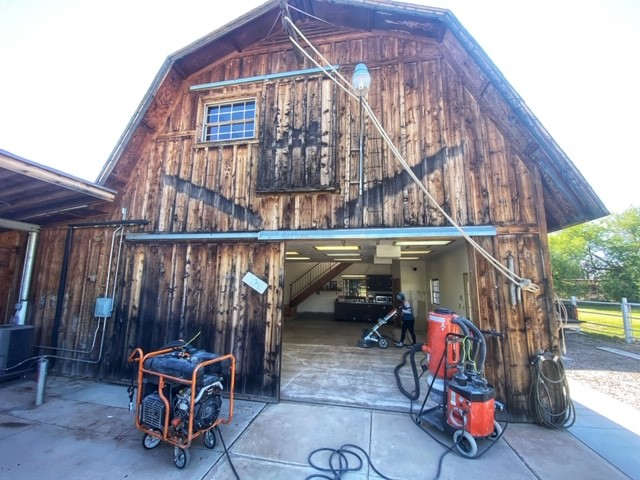 A barn with a concrete floor