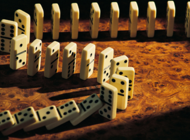 Dominoes lined up and ready to fall.