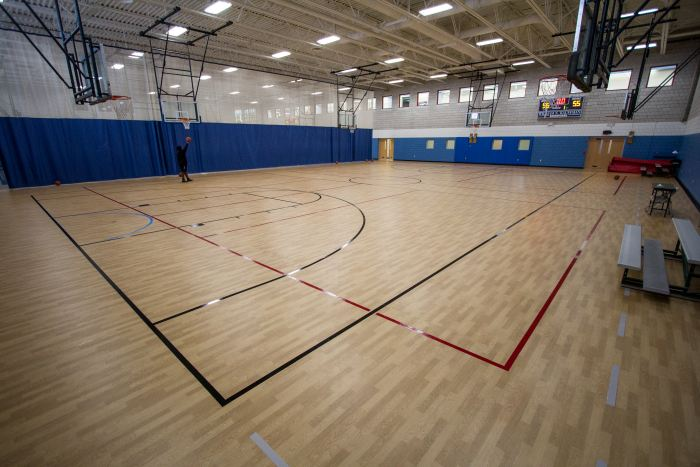 A fully restored gym in the Jewish Community Center after Laticrete helped bring the space back to life after a fire.