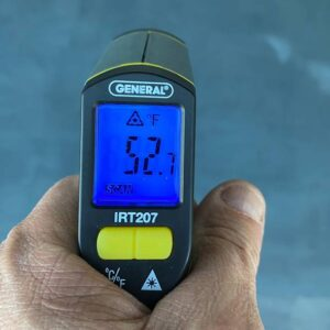 A laser temperature reader checking the temp of a floor.