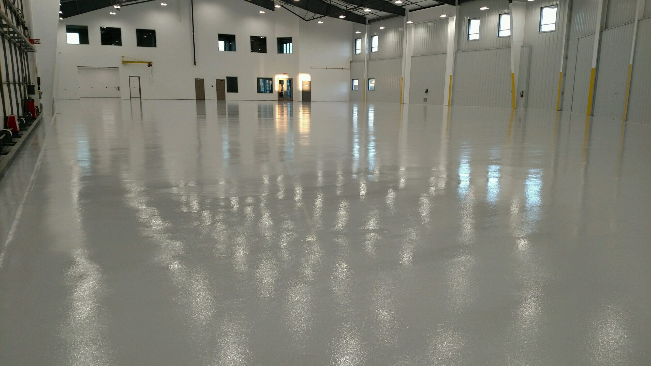An airplane hangar that has epoxy applied to it during a heat wave.