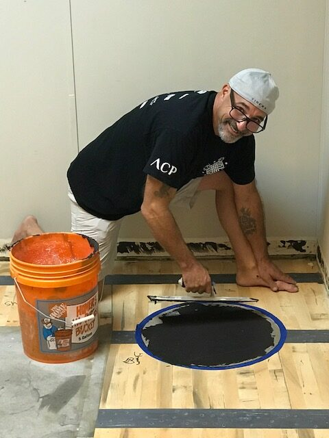 Dan Lynch of Louisiana posing for the camera as he works on his whiskey themed home office.
