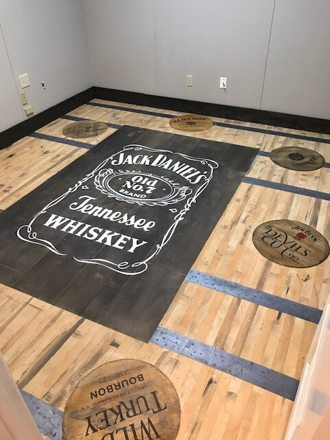 Vinyl stencils were created to make the Jack Daniel's whiskey label to be applied to the floor.