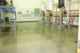 A warehouse space finished with bonded abrasive polished concrete