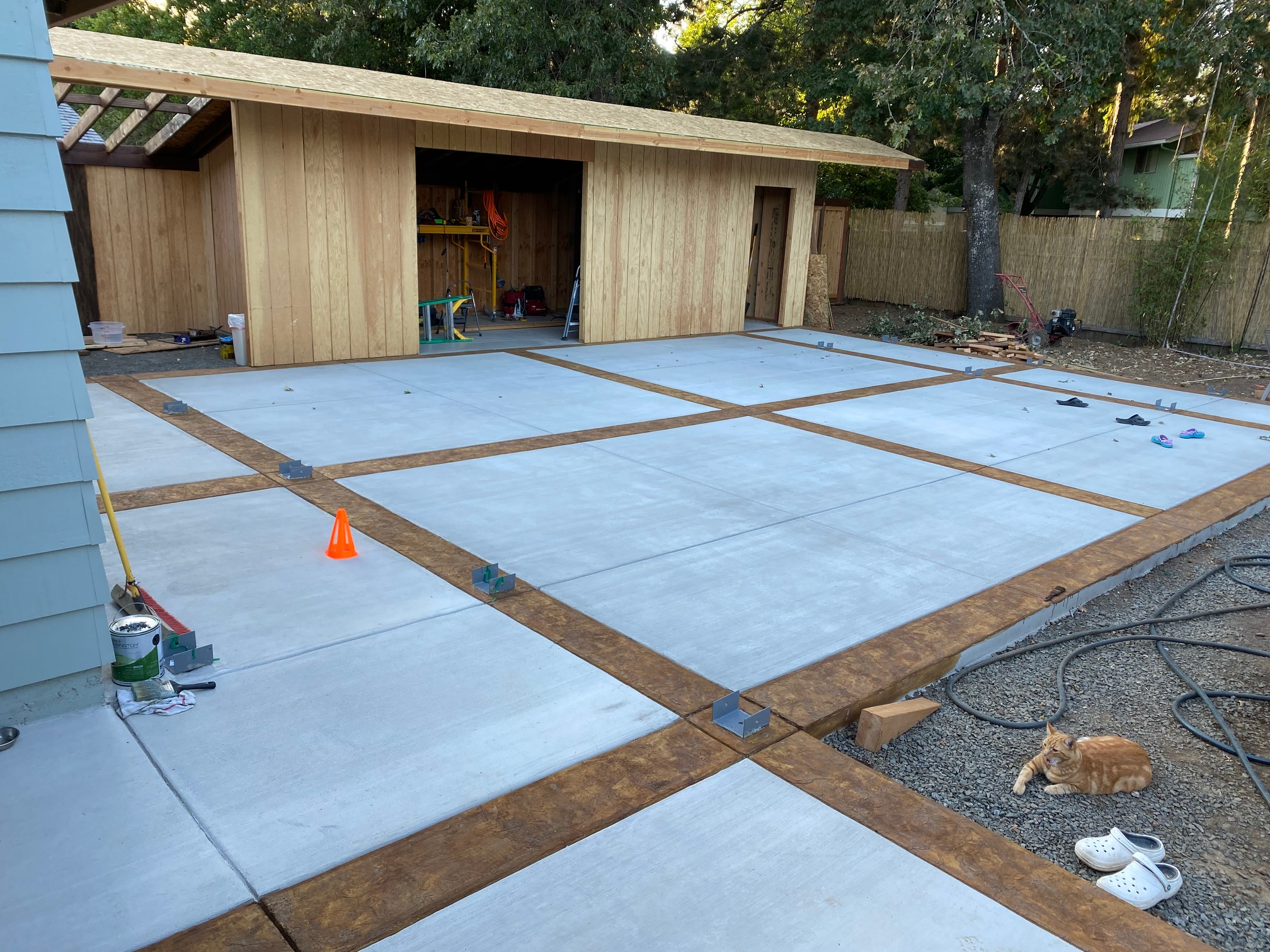 staining and texturing the borders of the concrete patio