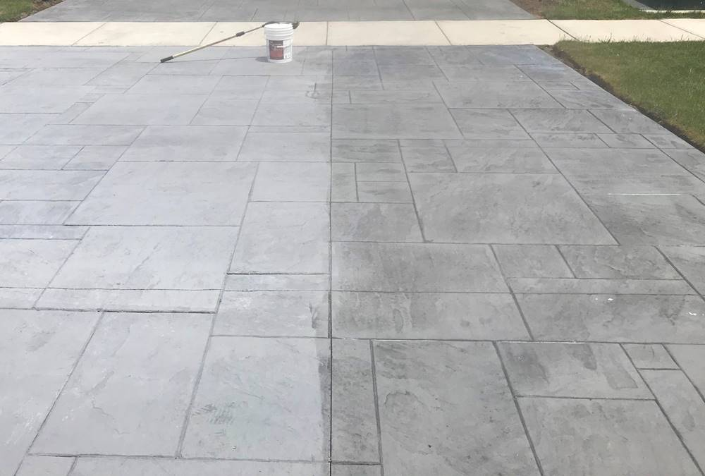 Concrete driveway that is stamped and then only halfway sealed with Decra-Seal by W. R. Meadows