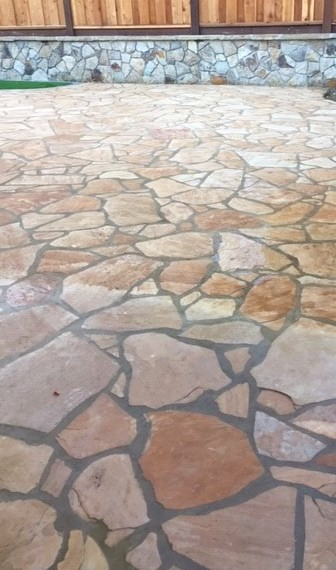 Traditional stamped concrete in a flagstone pattern sealed with Decra-Seal