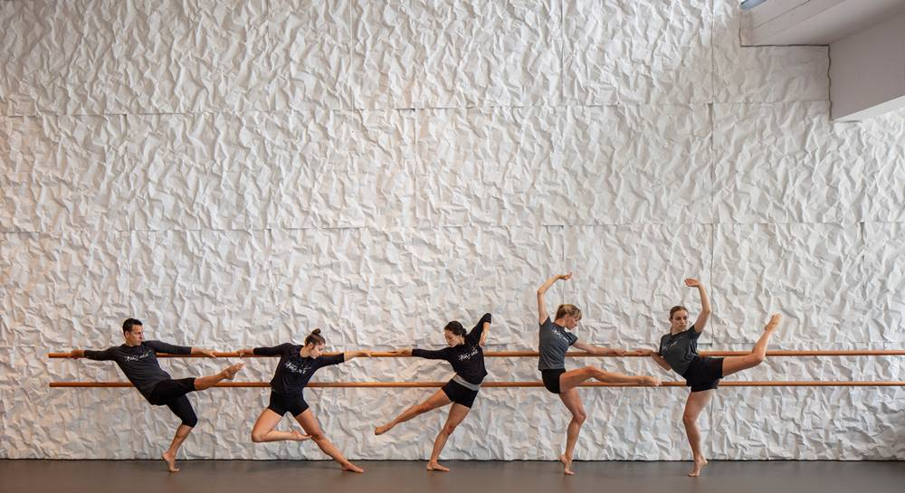 dancers in front of a concrete crinkle wall at the Kennedy Center Pavilions rehearsal space