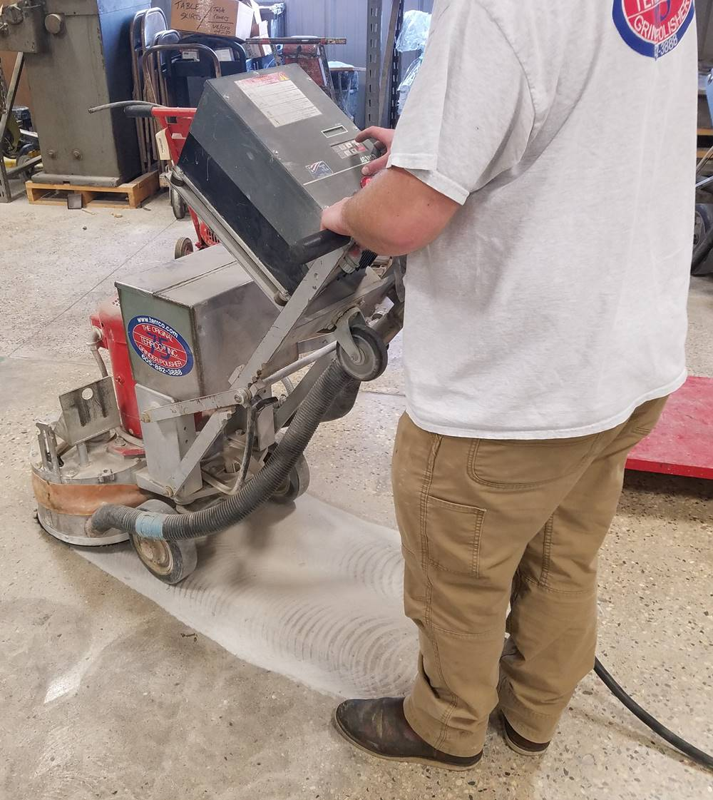 Terrco 701-S being used to grind a concrete floor.