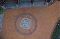 A compass rose on a concrete driveway