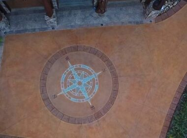 A compass rose on a concrete driveway