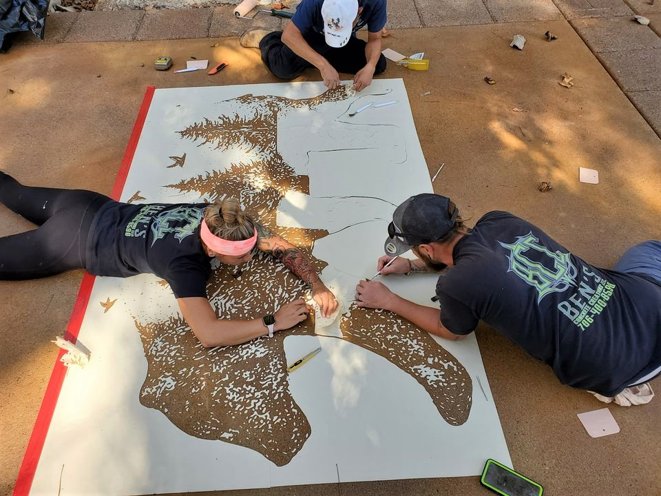 a crew works on installing a stencil on concrete fully embracing the decorative side of concrete
