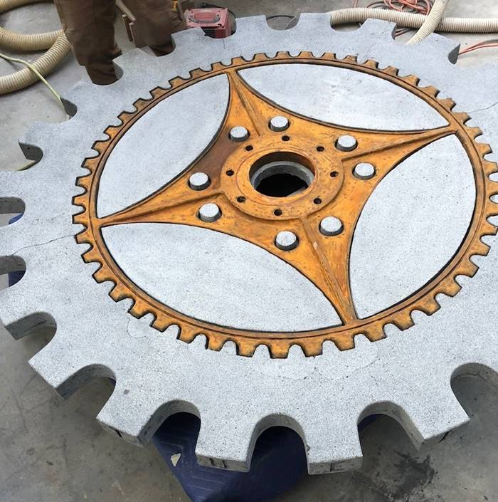 Close up on a concrete table that is like the gear in a machine before it has been completed