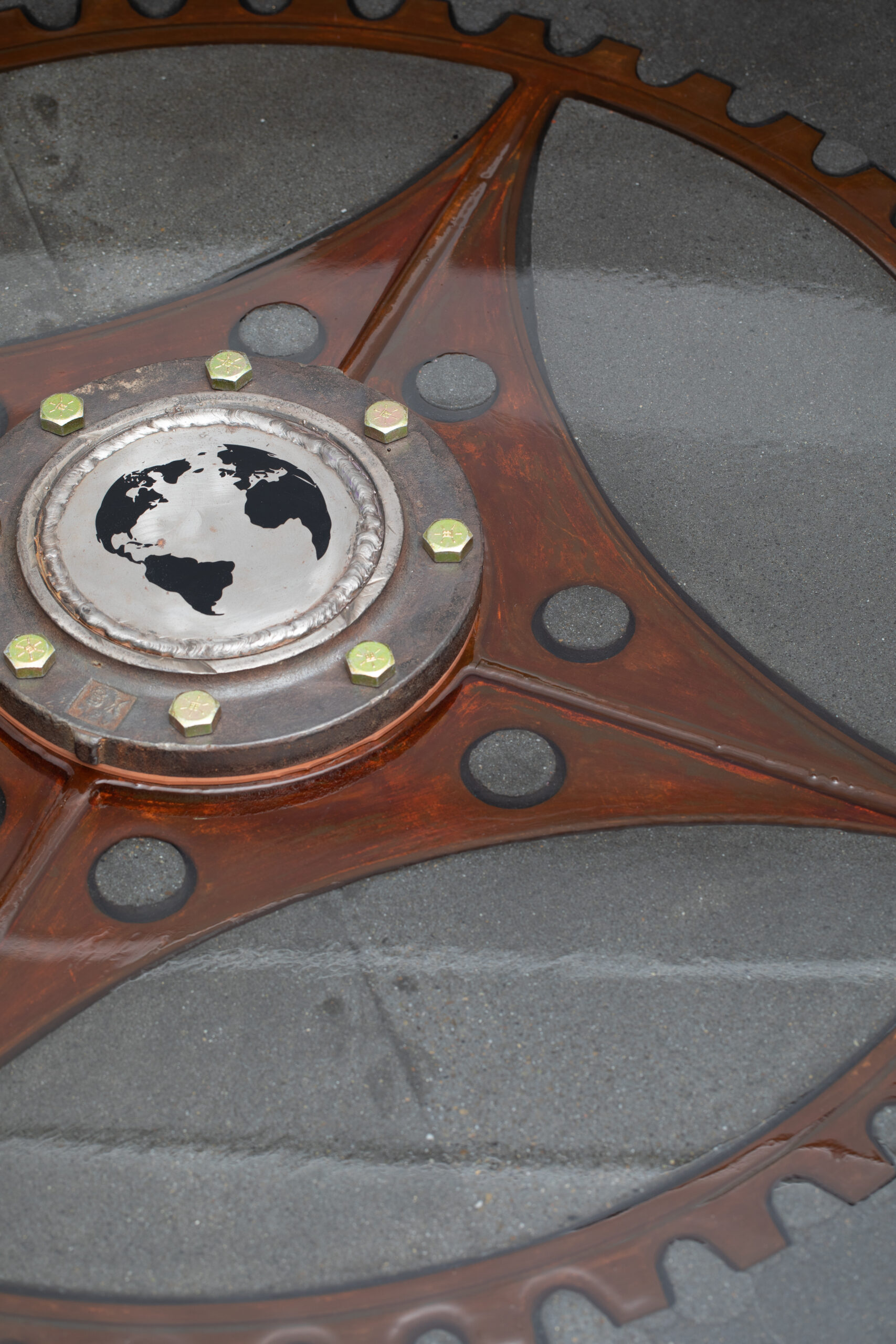 a close up look at the concrete gear table with cogs and intricate details