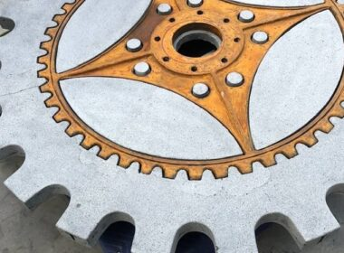A cut of the concrete table that takes the shape of a machine cog