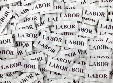 A pile of paper with the word labor on it