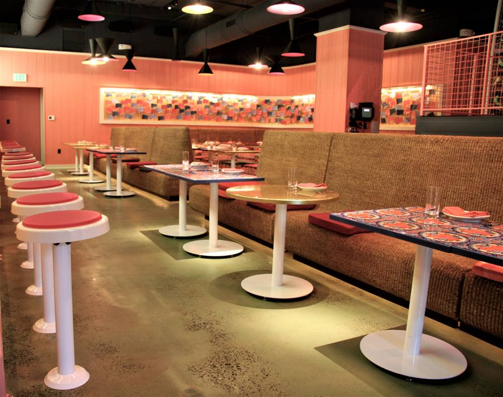 Stain can be a choice in choosing a topical colorant - like this stained concrete floor in a restaurant.