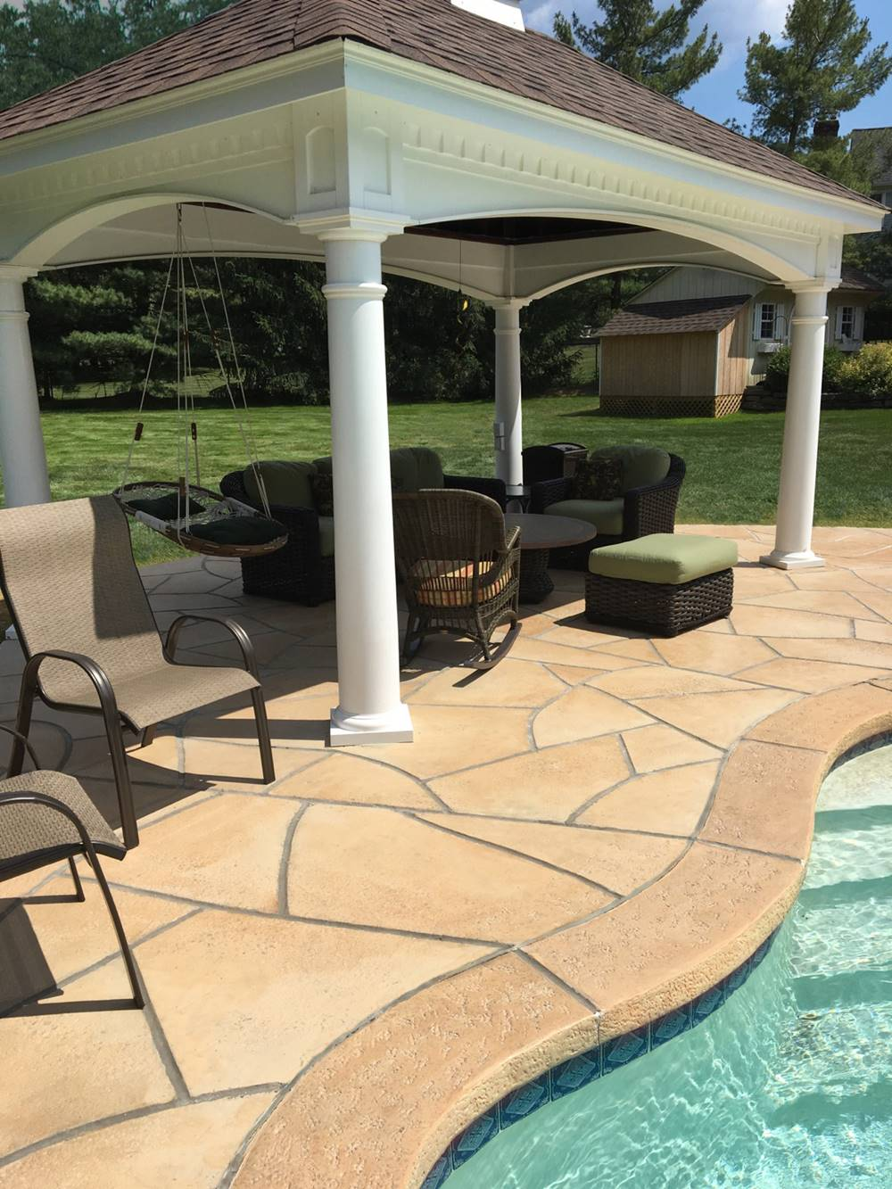A patio in lighter brown color to resemble a Tuscan look.