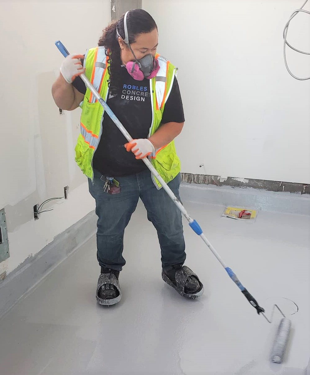 Concrete contractor Kimberley Robles puts a concrete finish into a grocery store in San Fran.