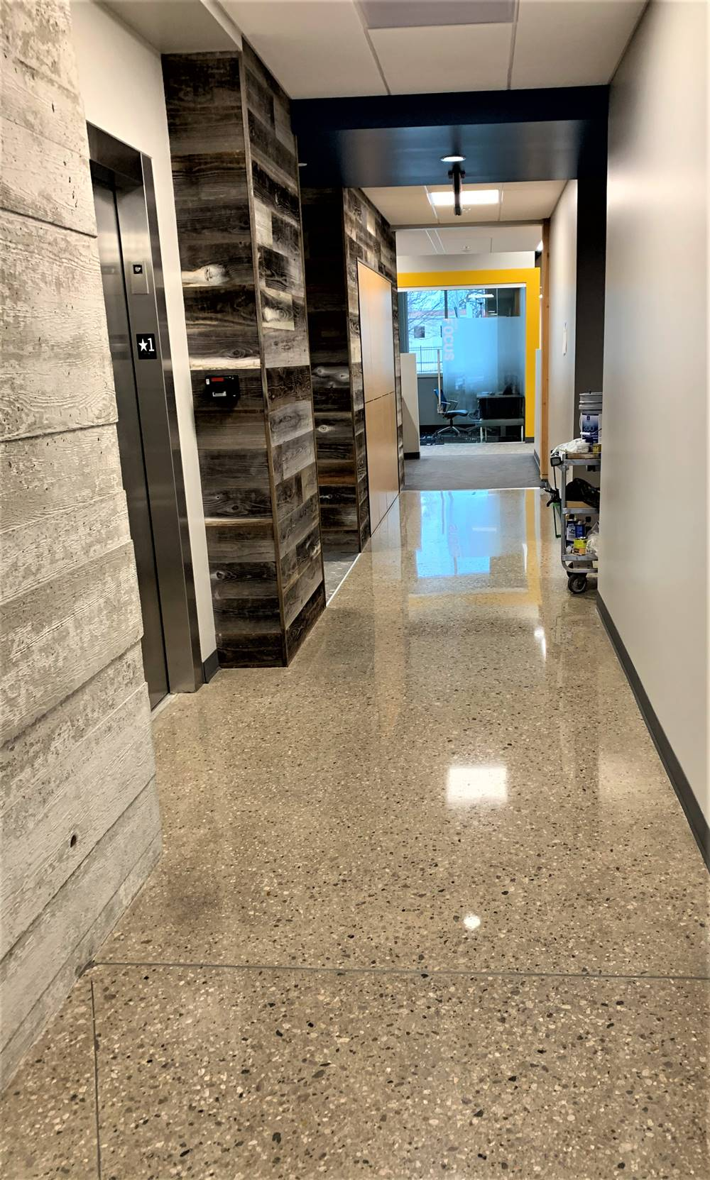 this hallway shows the results of using Skudo's commercial protection systems to protect the floor.