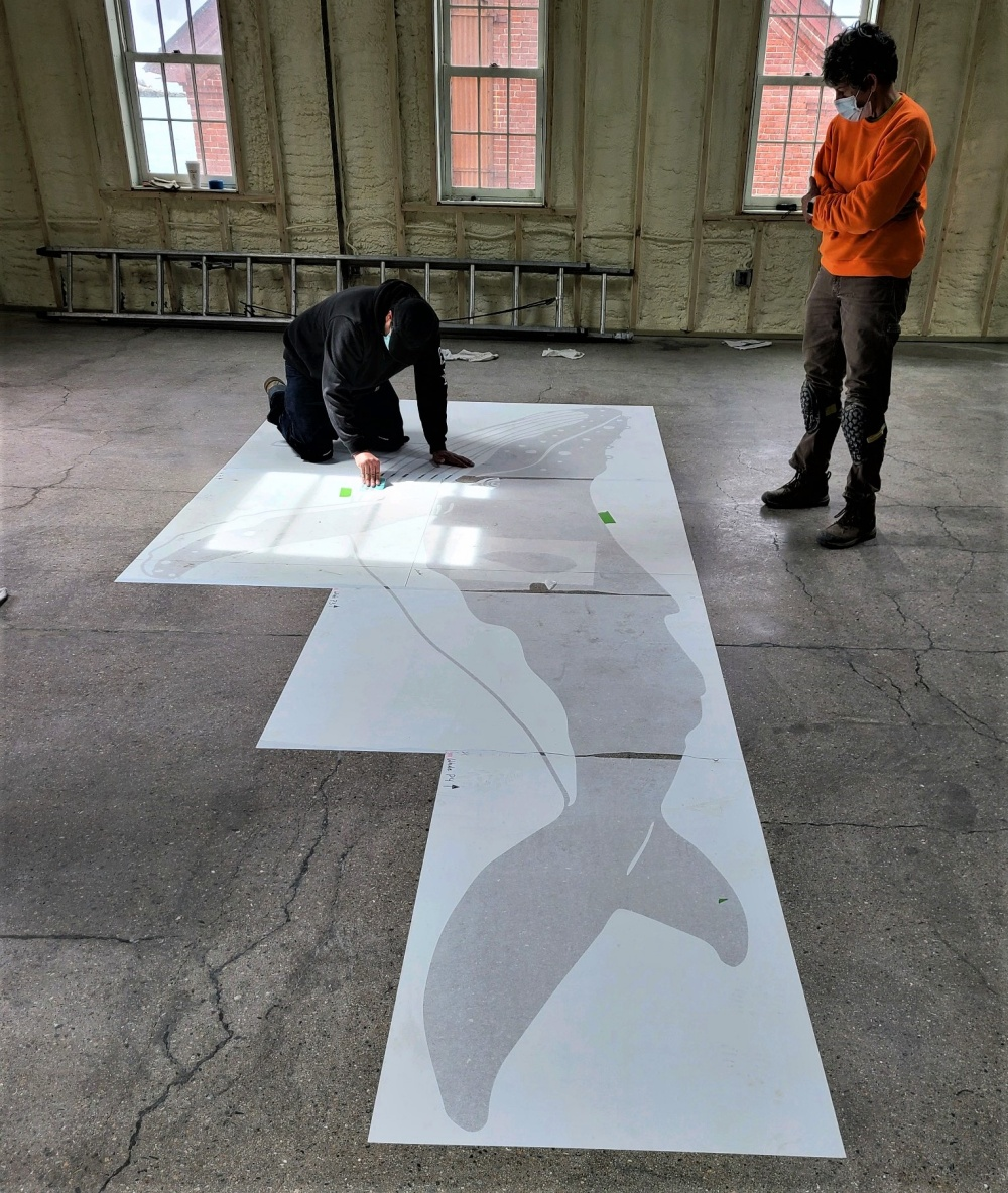 laying out the stencils for the concrete floor
