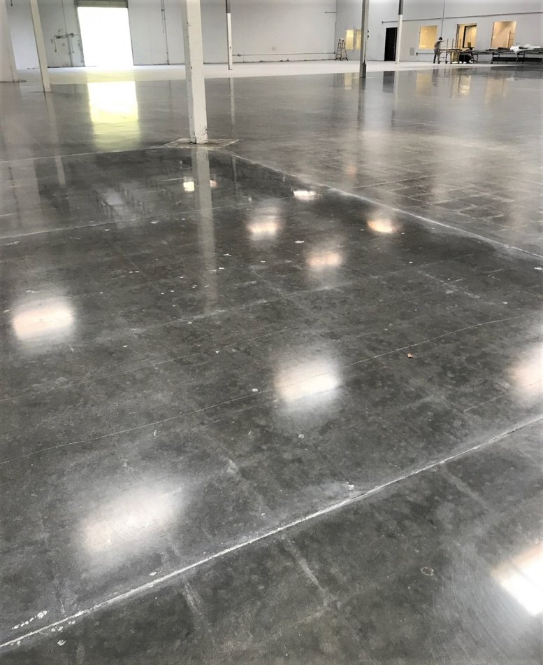 An shiny indoor concrete floor that is cleaned with Rainguard pro products