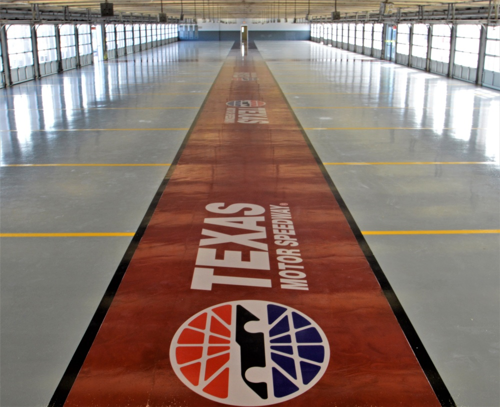 The complete garage at the Texas Motor speedway with a high-performance coating and a custom stencil logo