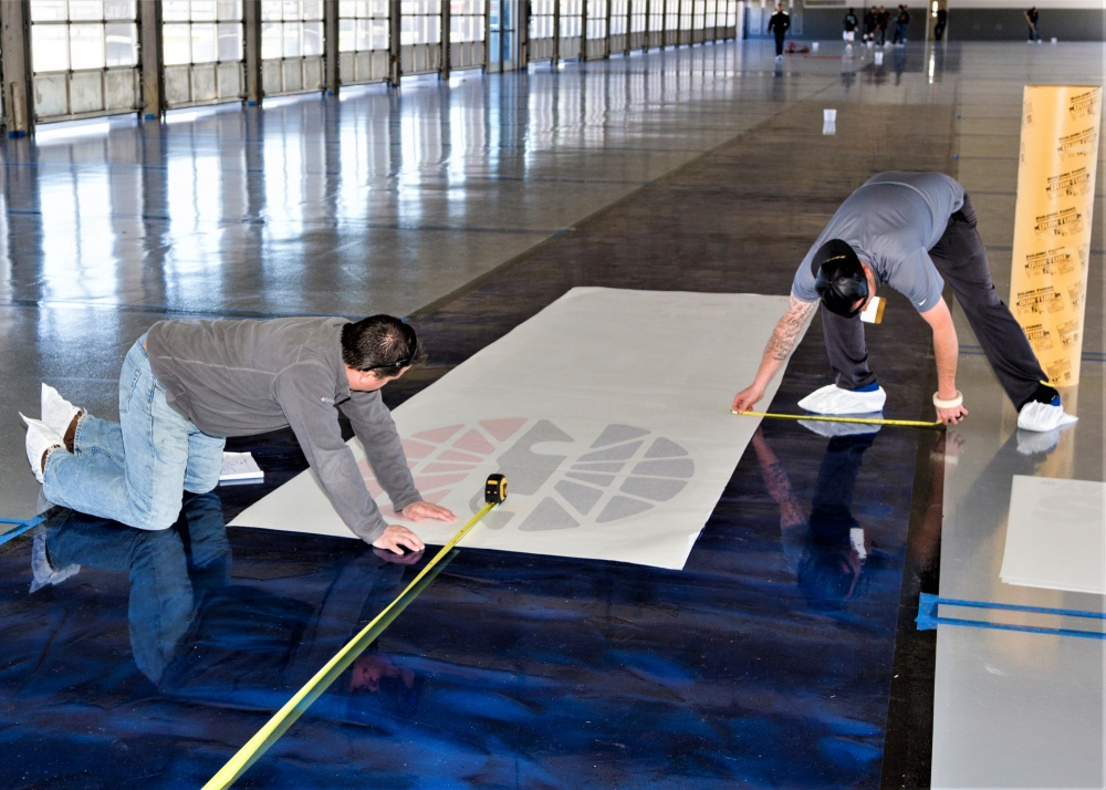 aligning the stencil on the concrete floor for the Texas Motor Speedway