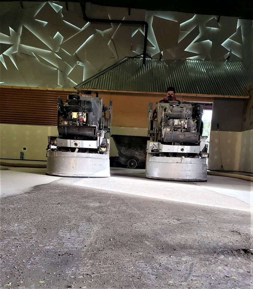 Two grinding machines side by side