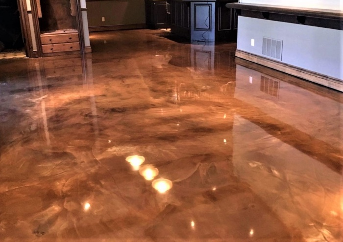 copper metallic epoxy dust was used to create movement and elegence on this concrete floor